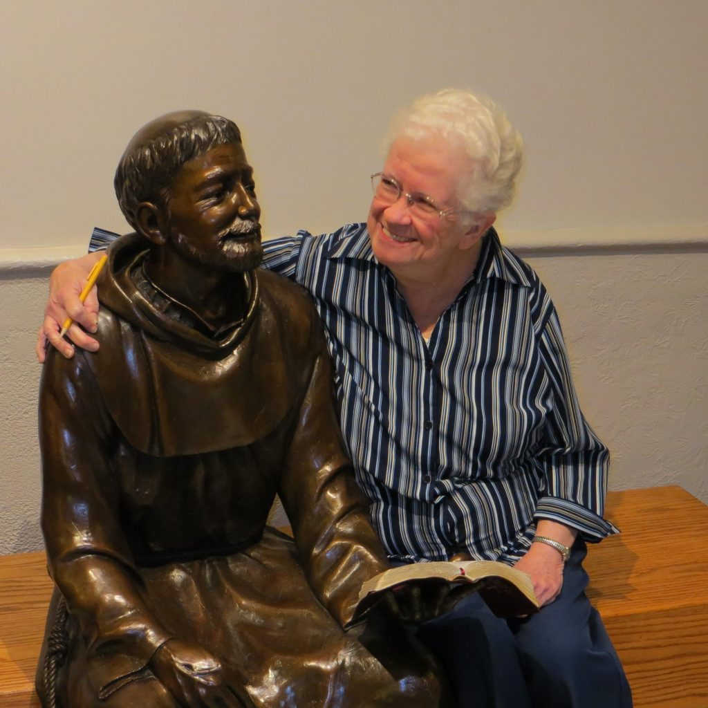 Sister Ann Marie Slavin with a statue of St. Francis
